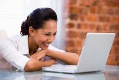 woman-with-laptop-laughing
